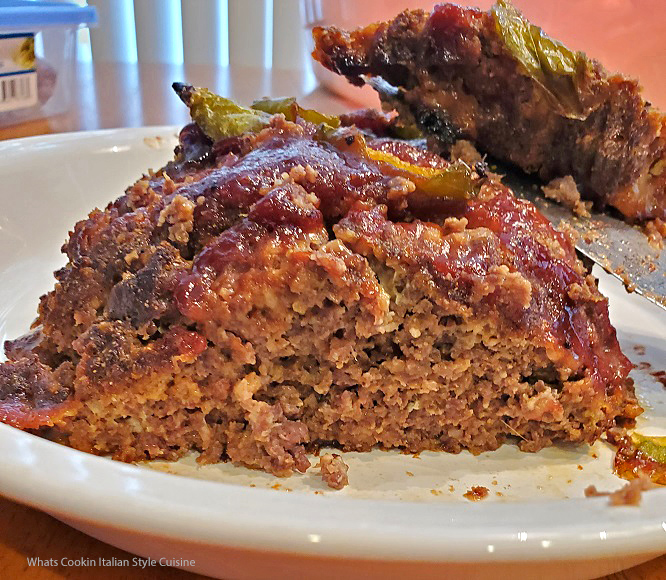 this is a sliced of venison meatloaf with barbecue sauce and peppers on top