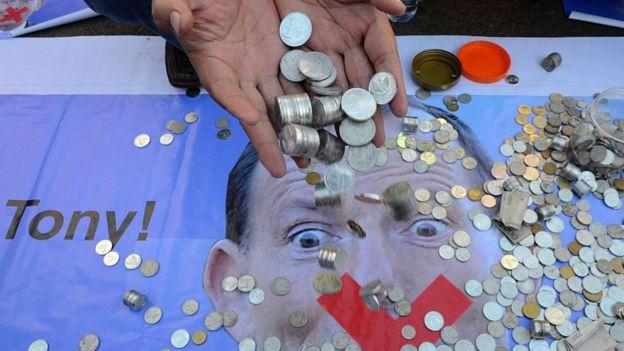 Pakar ekonomi silang pendapat soal masih aman atau tidaknya jumlah utang luar negeri Indonesia - Foto: AFP / Tribun Medan.