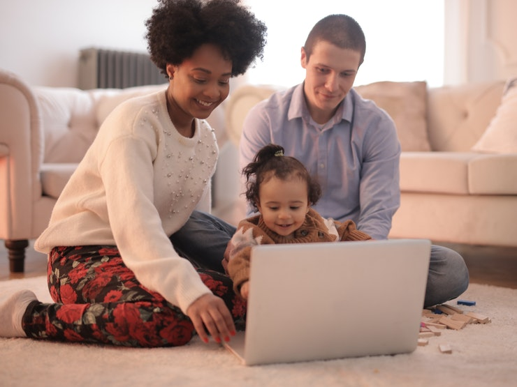 family with baby on laptop