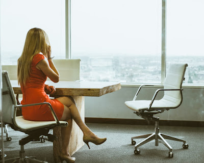 woman sitting at a conference table