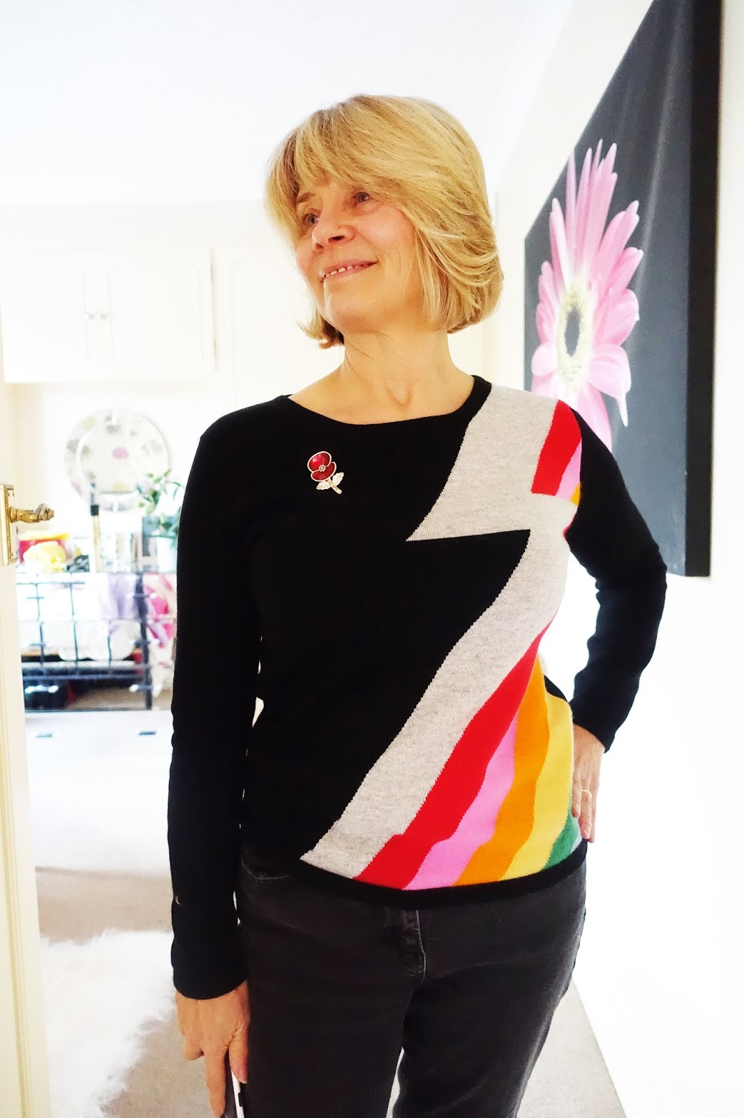 Black Bowie flash sweater from Orwell + Austen worn with black jeans and silver boots by over-50s style blogger Gail Hanlon