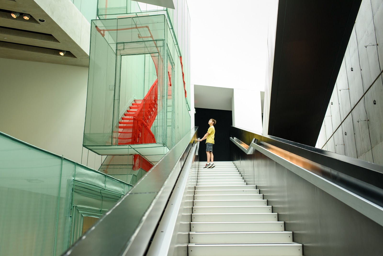 Looking at the fabric staircase from the steps at CAC exhibit by Do Ho Suh (photo by Diana Sherblom)