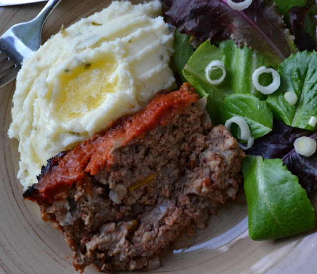 old fashioned meatloaf with garlic mashed potatoes on a plate