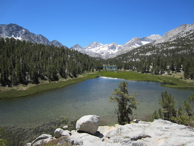 alpine lake surrounded by snow-capped mountain