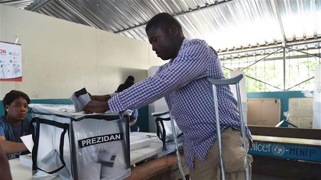 Haitians go to long-awaited polls to pick president, parliamentarians