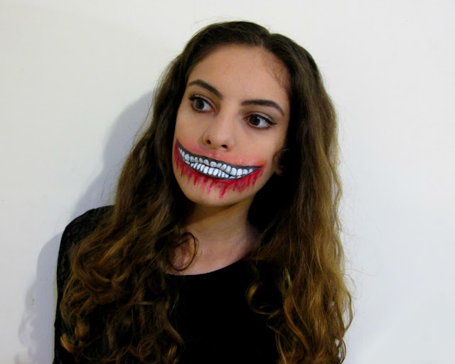 Halloween makeup, ripped mouth, dripping bood