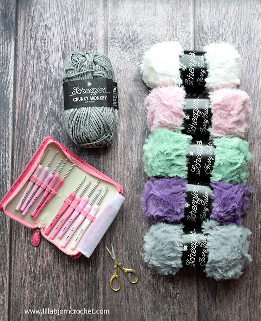Furry yarn and a set of pink Tulip crochet hooks
