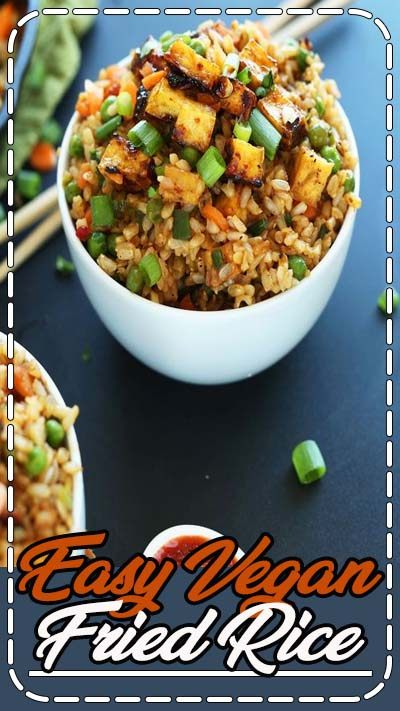 Easy, 10-ingredient vegan fried rice that's loaded with vegetables, crispy baked tofu, and tons of flavor! A healthy, satisfying plant-based side dish or entrée.