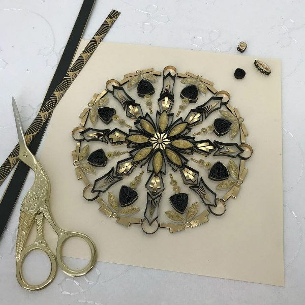 quilled mandala with metallic accents and example paper strips and detail stork scissors