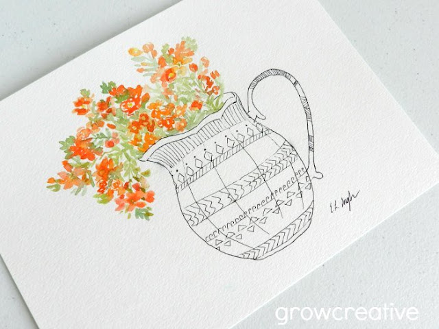 Orange wildflowers in a vase: growcreativeblog