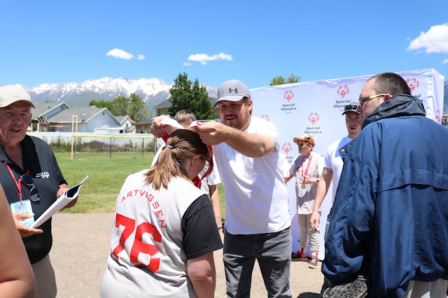 ProSoft volunteer awarding medals at Special Olympics