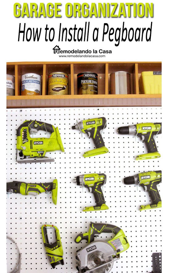 Ryobi power tools on a pegboard