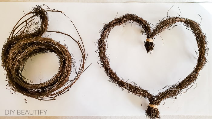 turn grapevine garland into a heart shaped wreath