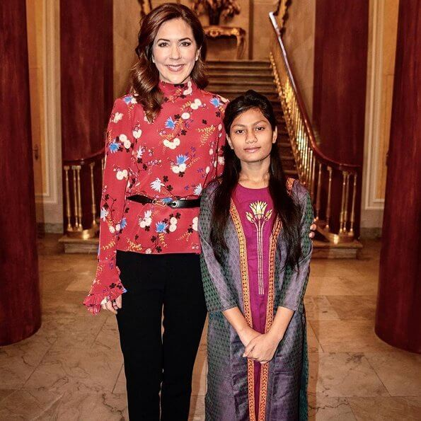 Crown Princess wore a floral print mock-neck ruffle-sleeve blouse by Erdem. 14-year-old Farzana from Dhaka