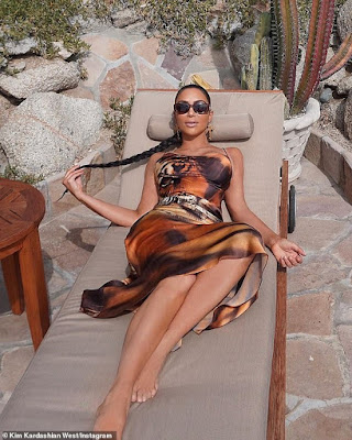 Kim Kardashian flaunts her hot banging body in tiger-print dress for latest beach shoot