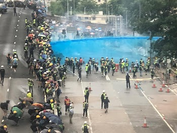 Hong Kong police spray protesters with blue-dyed water cannons