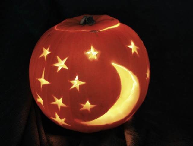 Pumpkin with stars and moon lit up