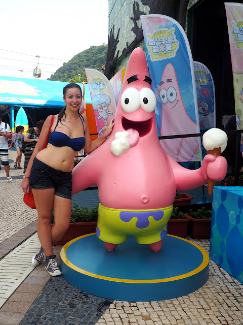 Posing with Patrick statue at the Spongebob Squarepants water playground feature at Ocean Park