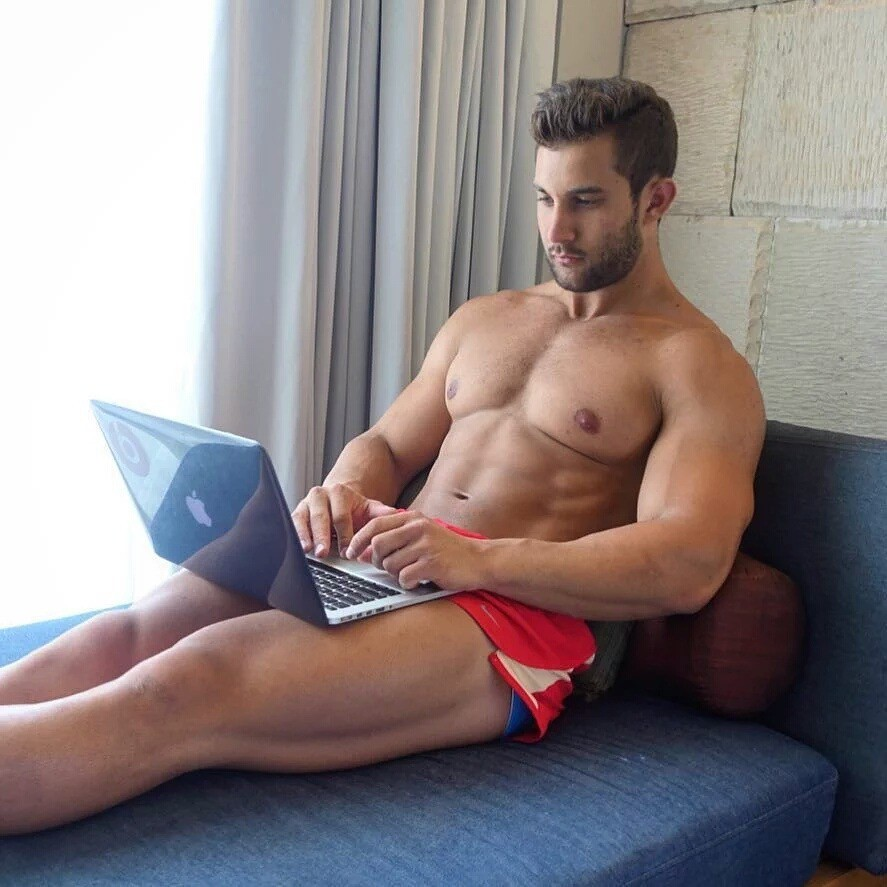hot-man-using-laptop-computer