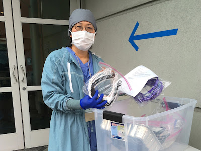 Nurse receives face shields at UCSF.