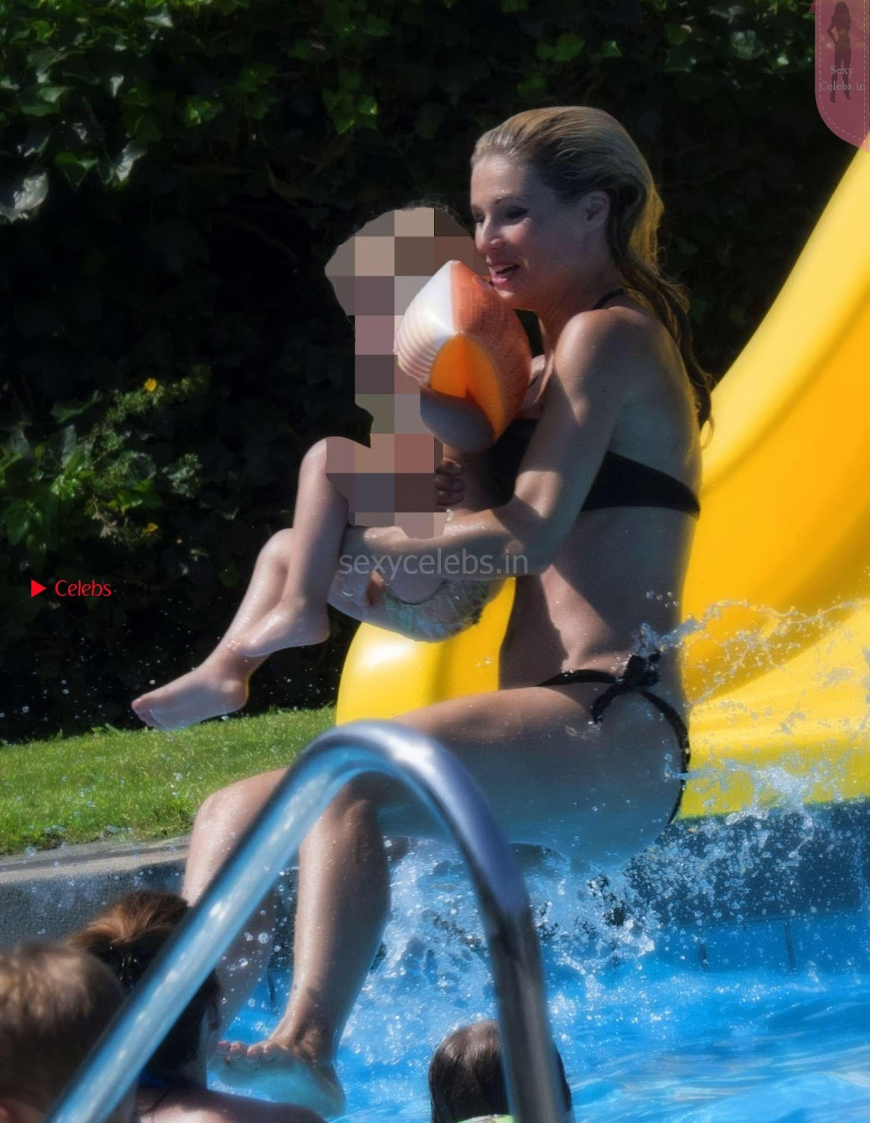 Michelle Hunziker in wet Black Bikini having fun wow sexy naughty babe August 2017
