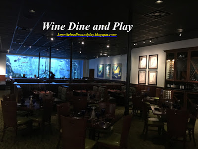 The dining room with aquarium at RumFish Grill in St. Pete Beach, Florida
