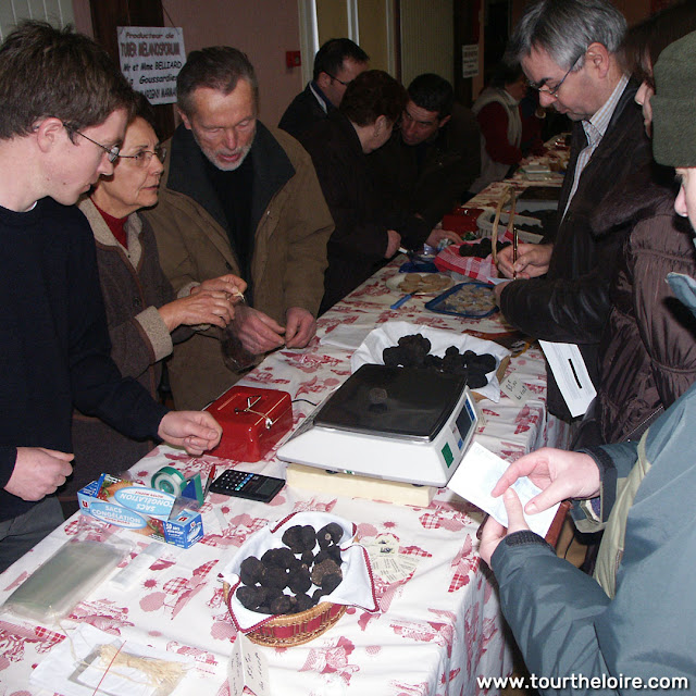 Buying a truffle at a market, Indre et Loire, France. Photo by Loire Valley Time Travel.