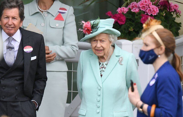 Queen Elizabeth wore an aquamarine coloured coat and dress and a matching hat adorned with pink flowers. Palm Leaf brooch