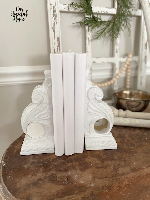 white corbel bookends drapery sconce white books