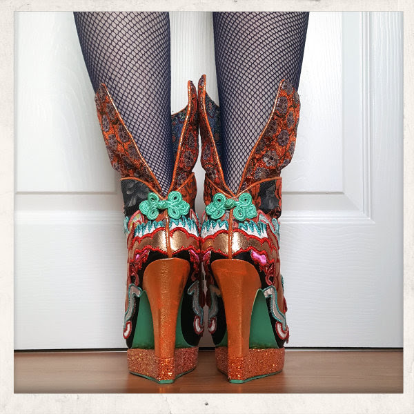 back view wearing Irregular Choice dragon boots with cuff worn up and fishnet tights