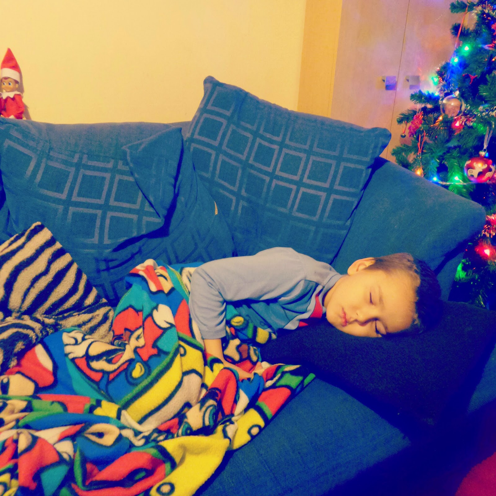Big Boy asleep and poorly on the sofa