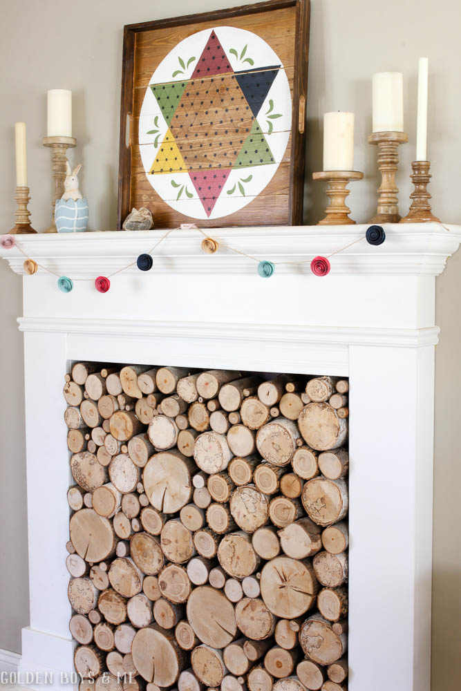 Colorful spring mantel decor with wood checkers board