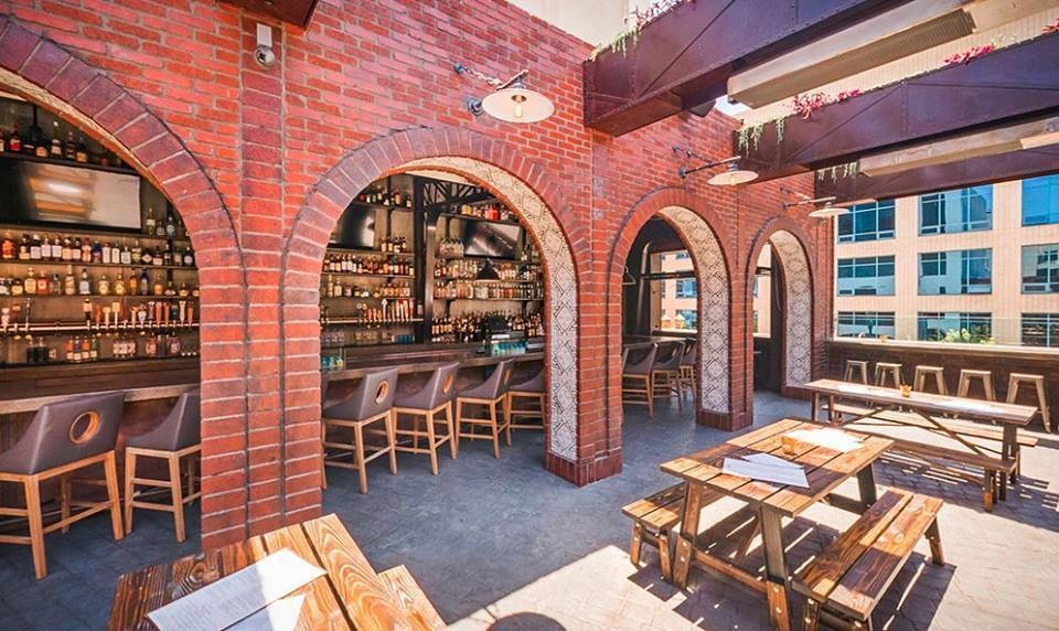 The World's 30 Best Rooftop Bars… Everyone Should Drink At #9 At Least Once. - The Roof Tap beer garden is part of sunny Long Beach, California.