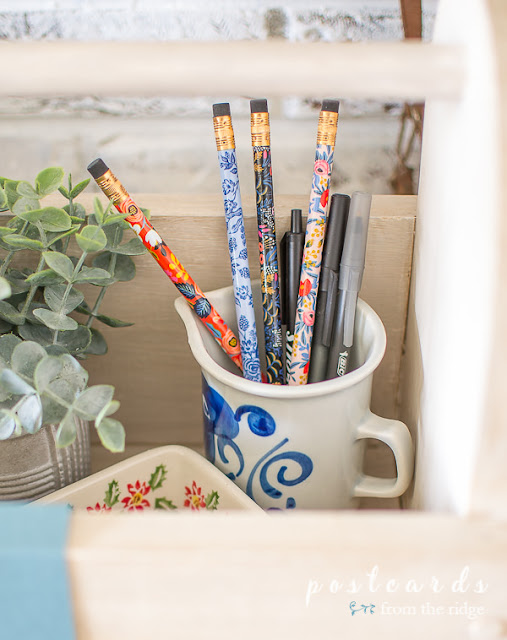 rifle paper pencils in a blue and white little creamer pitcher