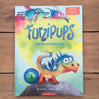 """""""Furzipups, der Knatterdrache"""" von Kai Lüftner, illustriert von Wiebke Rauers, erschienen im Coppenrath Verlag, Bilderbuch mit Pups-Button zum Mitmachen"""