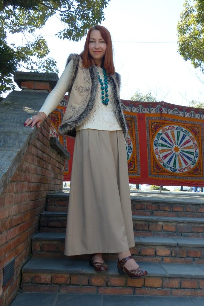 Outfit in nudes: sweater, vest, maxi skirt