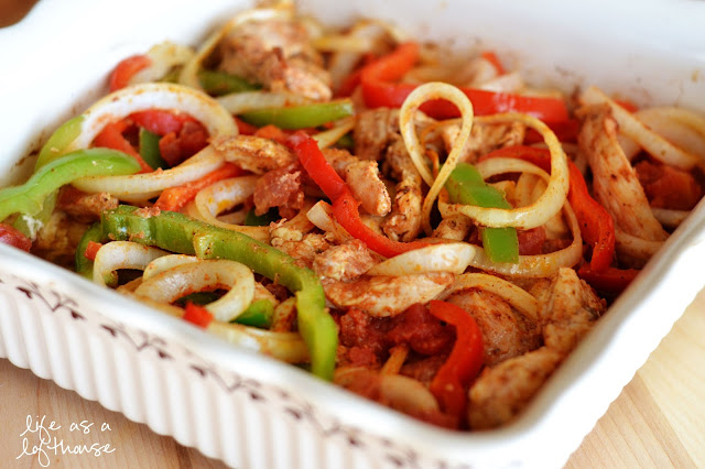 Oven Baked Chicken Fajitas are filled with flavorful chicken, onion, tomatoes and red and green bell peppers. Life-in-the-Lofthouse.com