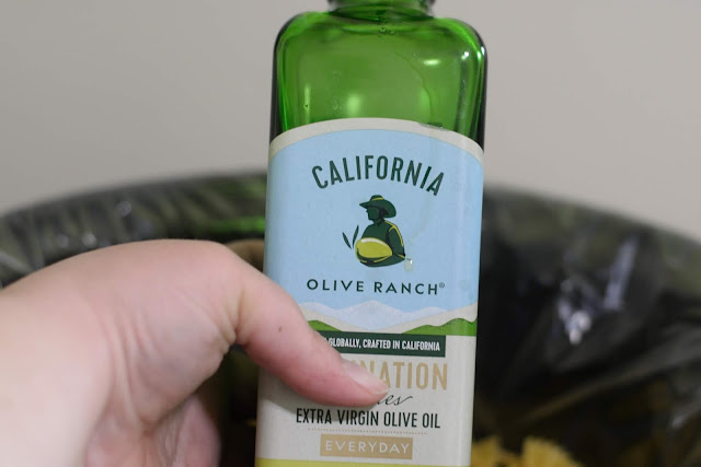 A bottle of extra virgin olive oil.