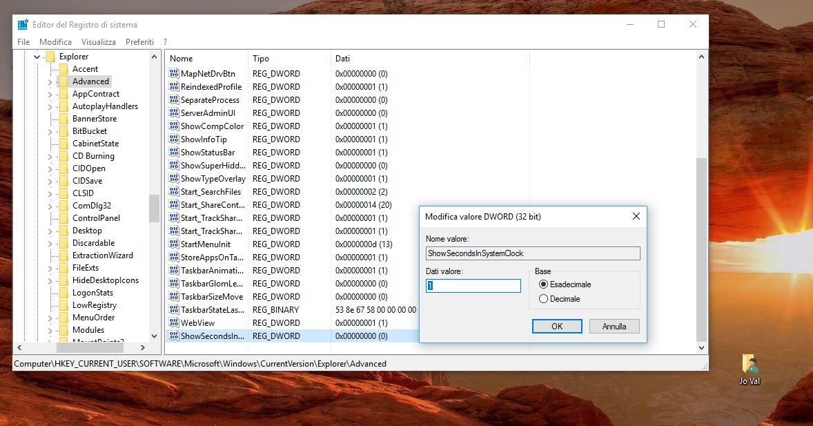 Come visualizzare anche i secondi sull'orologio della Taskbar in Windows 10 3 HTNovo