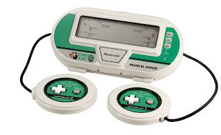 DK3, maquinita para dos jugadores con dos mandos unidos por un cable a la pantalla