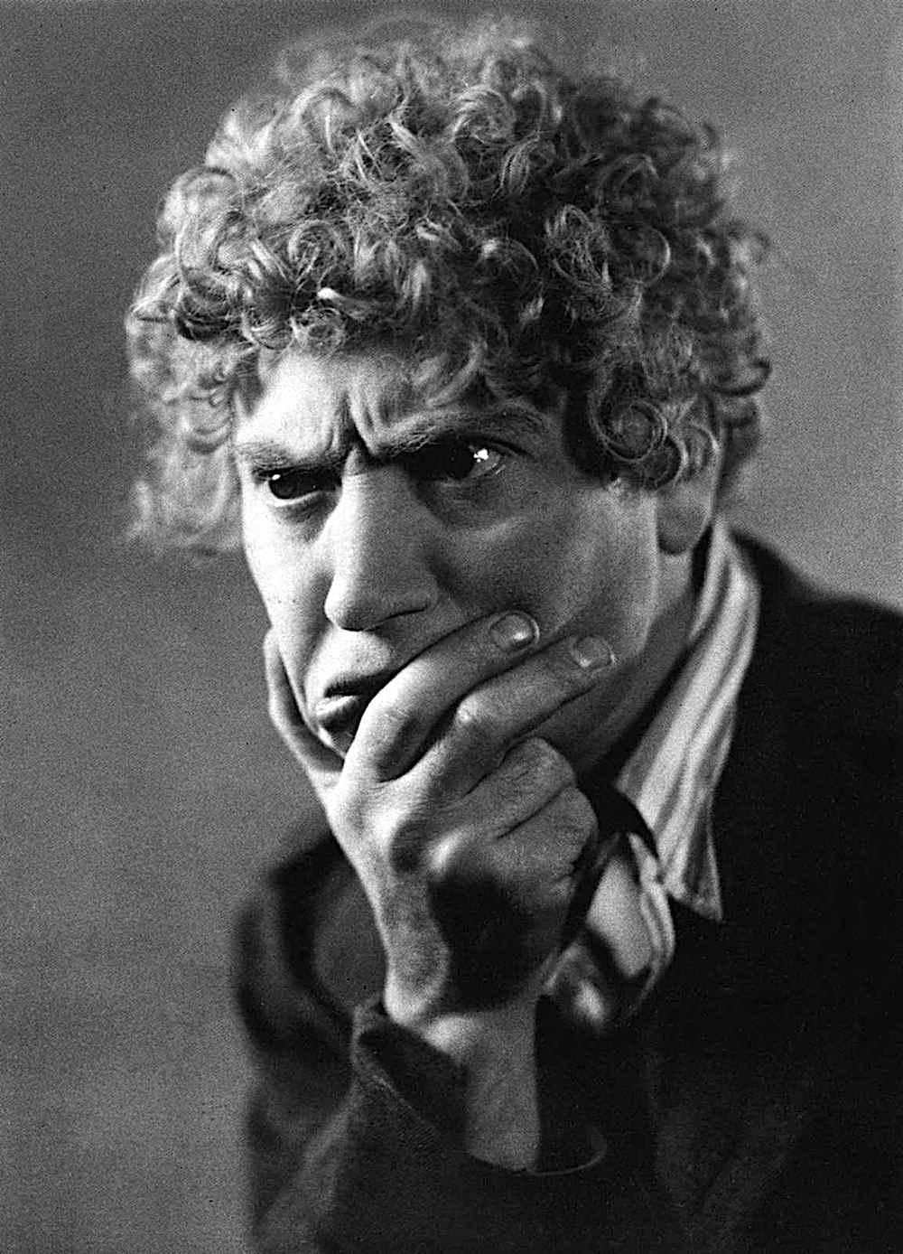 a Harpo Marx portrait photograph, the thinker