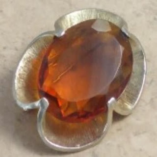 Large amber rhinestone brooch by Exquisite