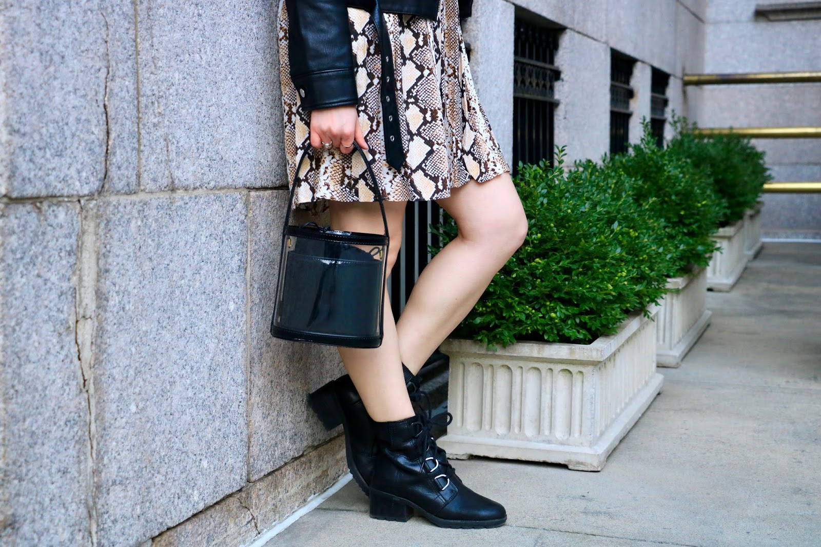 Nyc fashion blogger Kathleen Harper carrying a Staud black and clear bucket bag.