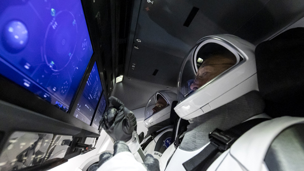 Inside their Crew Dragon capsule, NASA astronauts Doug Hurley and Bob Behnken go through procedures that they will carry out during launch day on May 27, 2020...weather permitting.