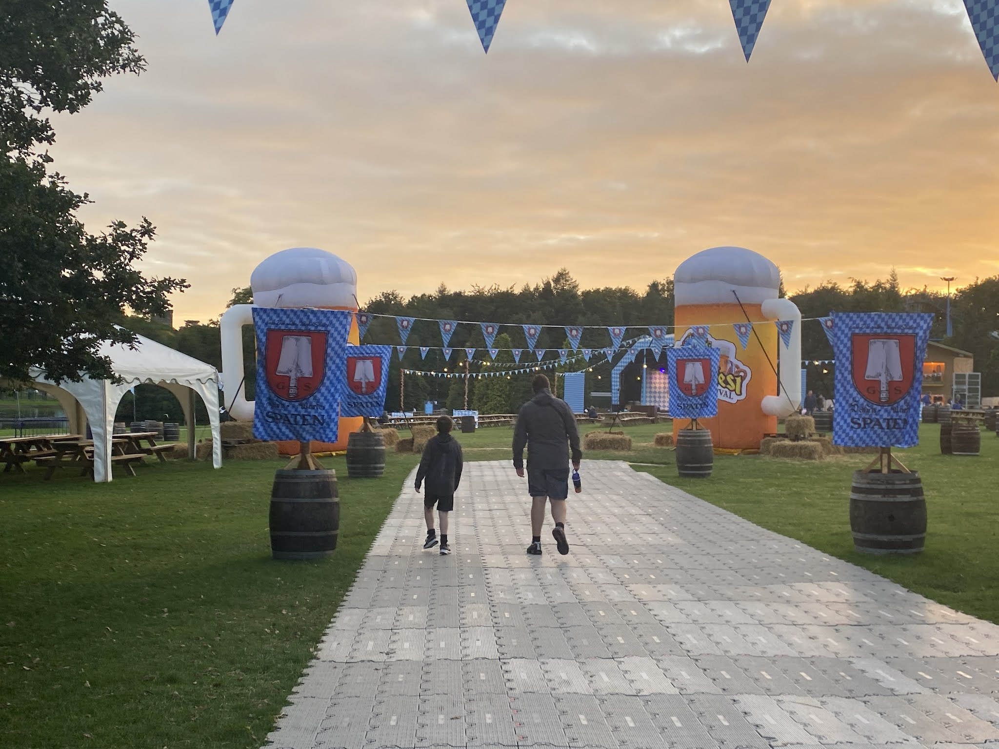 two boys walking in to Oktoberfest