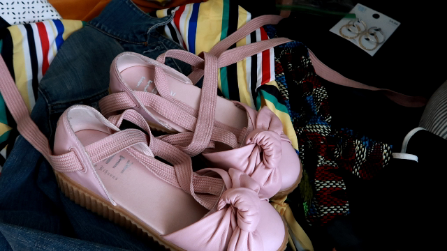 Image: Pink shoes, and clothes Tangie Bell is gathering up to thrift away or toss away