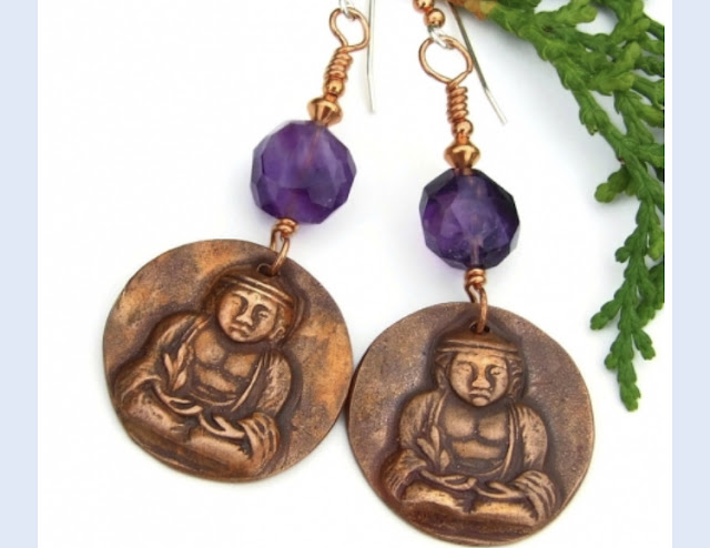https://www.shadowdogdesigns.com/product/buddha-yoga-earrings-amethyst-crown-chakra-meditation-handmade-jewelry?tid=372