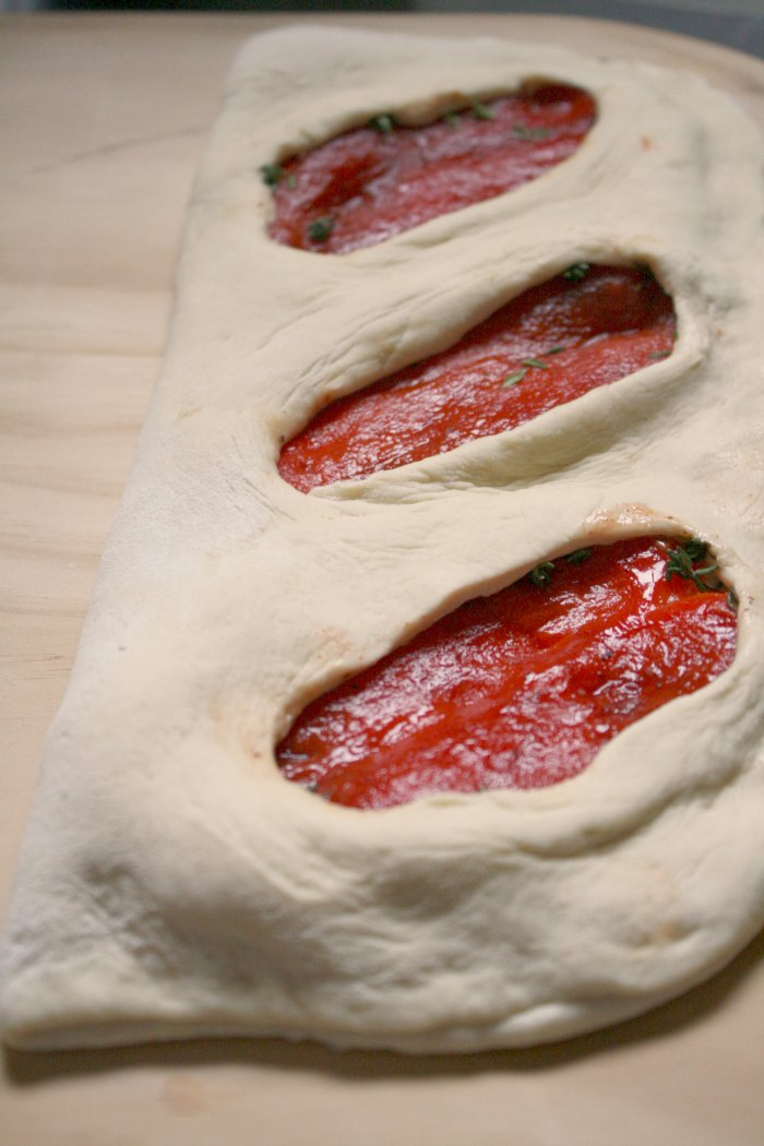 dough folded over peppers