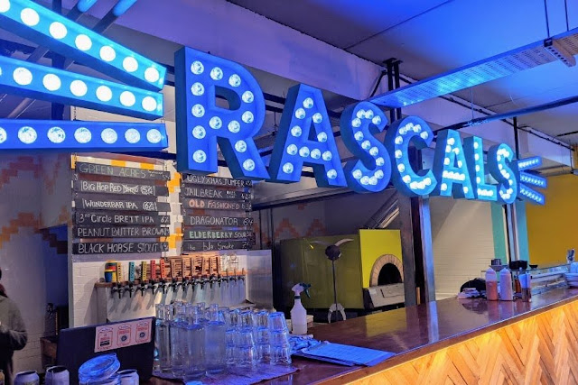 Neon sign over the bar at Rascal's HQ Brewery in Inchicore