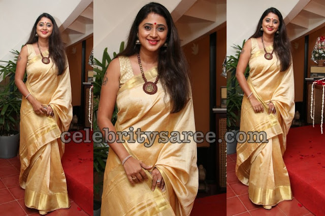 Kanika Cream and Gold Saree